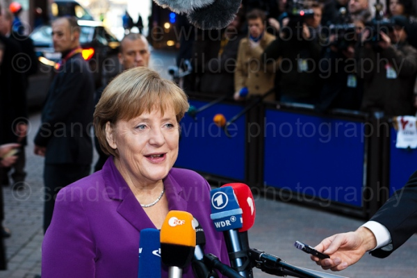 Angela Merkel smiles at the press